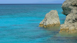 Crystal Clear Turquoise Sea with Cliff Footage