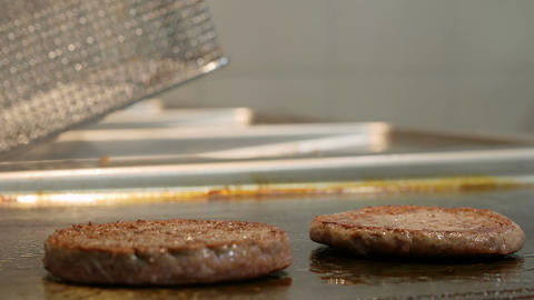 cooking burgers on the plate Footage