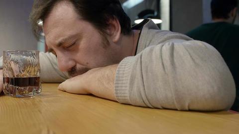 depressed drunk man at the pub Live Action