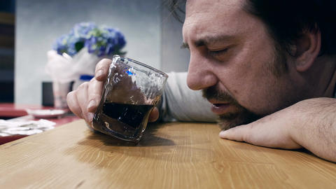 mature man is getting drunk due his problems Live Action