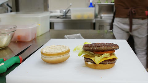 building a giant burger sandwich: fast food kitchen Footage