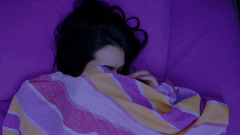 night shot of a young woman sleeping in bed Footage