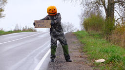 Winter is coming alert from pumpkinhead freak, halloween prank at road Footage