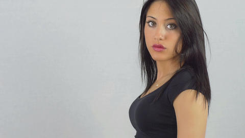 beautiful woman portrait: woman turns her face to the camera with serious mood Footage