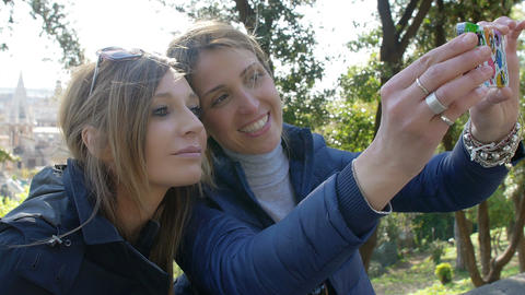 two friends taking a selfie: female friends Live Action