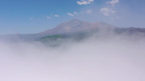 Flying above the clouds over the island of Tenerife - a view of the settlements Live Action