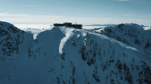 Aerial view of the ski resort - gondola lifts, restaurant, skiers skiing on the Live Action