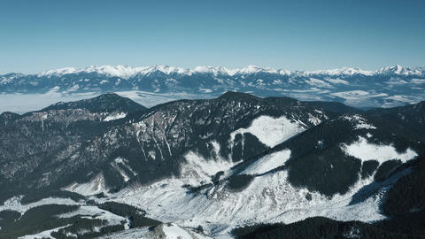 Aerial view of the snowy High Tatras Mountains in clear weather. Slovakia Live Action