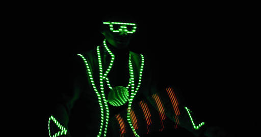 Professional dancer at the club in glowing lights dancing on stage, 4k Live Action