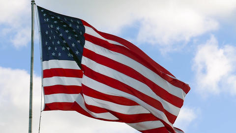 American flag waving slowly in the wind, close up Live Action
