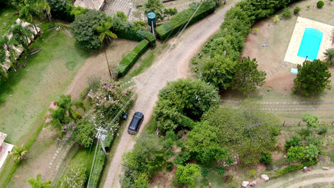 Aerial view of 4x4 car on dusty road in the green valley in tropical country Live Action