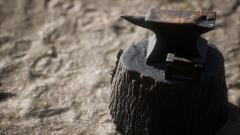 Old anvil attached to a stump Live Action