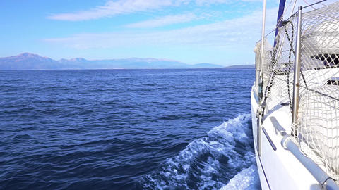 Calm Sea and Sailing Yacht. Slow Motion Live Action