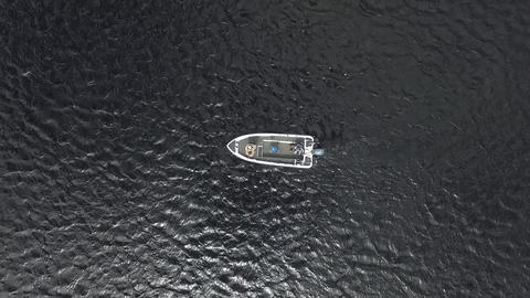 Drone Shot of Men Fishing In A Boat Live Action