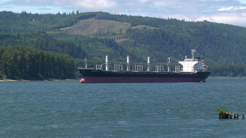 Shipping Vessel Anchored In Water With Mountainous Backdrop Live Action