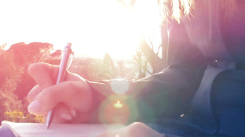 sad woman writing a diary at the sunset: pensive woman, thoughts, confessions Footage