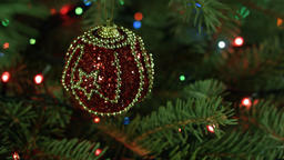 Magically decorated Christmas Tree with balls, ribbons and garlands on a blurred Footage
