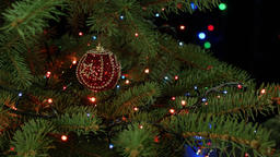 Magically decorated Christmas Tree with balls, lights blurred lights on dark bac Footage