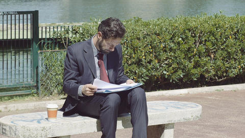 young businessman working outdoor and drinking a coffee to go Footage