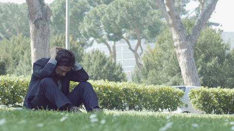 sad and depressed businessman: worried businessman Live Action