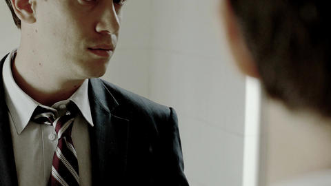 businessman at the mirror: businessman preparing for the success Live Action