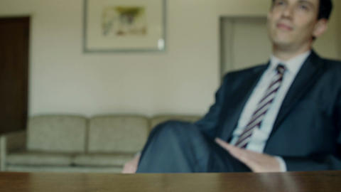 Relaxed businessman putting his feet up in the office Footage