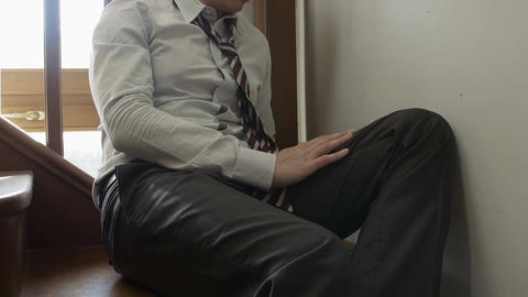 sad businessman sitting on the stairs: depressed... Stock Video Footage