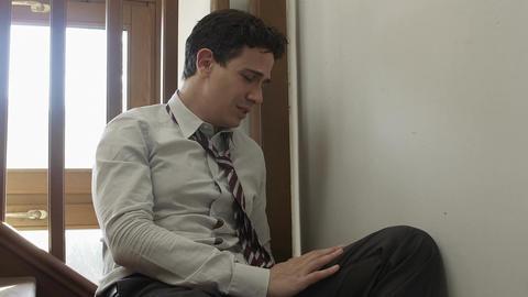 sad businessman sitting on the stairs: depressed businessman, bankrupt Live Action