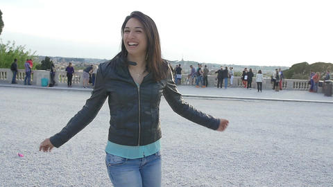 very happy woman dancing in the square: happy young girl does pirouettes Footage