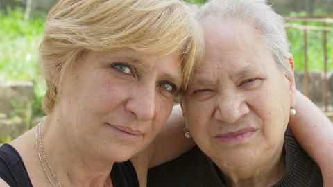 old woman and mature woman portrait: family lifestyle... Stock Video Footage