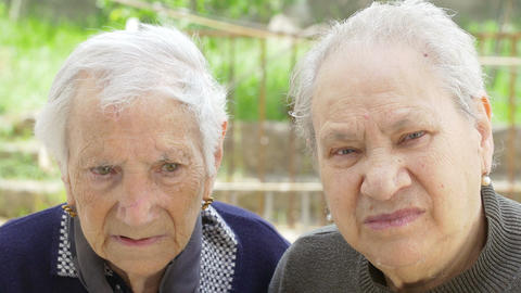 two thoughtful elderly women Live Action