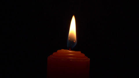 Candle Flame Slow Motion - Red Candle Burns Then After Three Tries Is Blown Out Live Action
