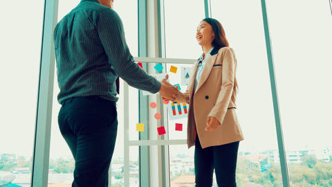 Business people handshake in corporate office Live Action
