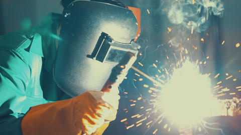 Metal welder working with arc welding machine Live Action