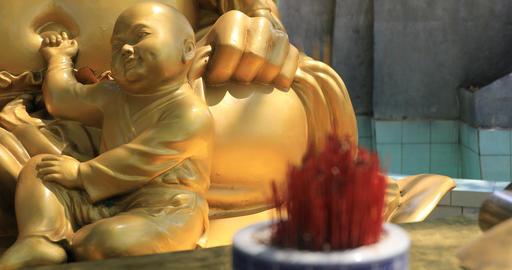 A buddhism statue at Suoi Tien park in Ho Chi Minh Vietnam closeup Live Action