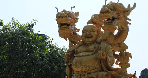 A buddhism statue at Suoi Tien park in Ho Chi Minh Vietnam handheld Live Action