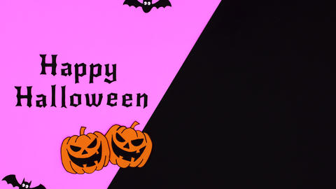 Happy Halloween text, pumpkins, bats and ghosts appear on purple black theme. Stop motion Animation