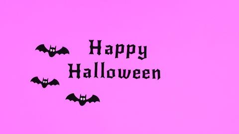 Bats fly around Happy Halloween text on purple theme. Stop motion Animation