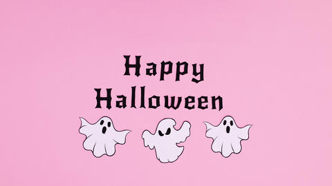 Happy Halloween text and ghosts fly around text .Stop motion Animation