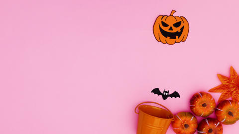 Halloween stickers appear from orange pot. Stop motion Animation