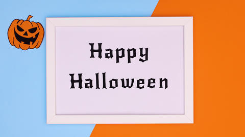 Happy Halloween text appear in frame on blue orange theme. Stop motion Animation