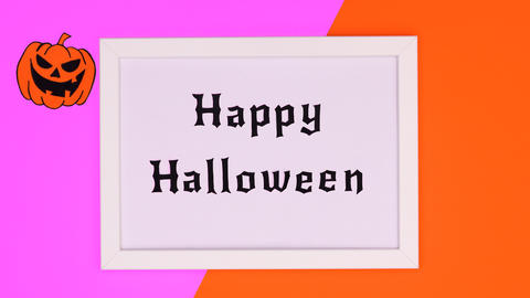 Happy Halloween text appear in frame on purple orange theme. Stop motion Animation