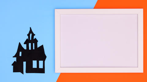 Frame for text and creepy Halloween house appear on blue orange theme. Stop motion Animation