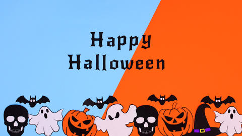 Words appear and make Happy Halloween text above Halloween stickers. Stop motion Animation