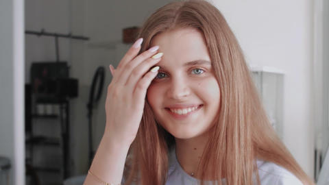 Young happy female model looks at the camera and smiles Live Action