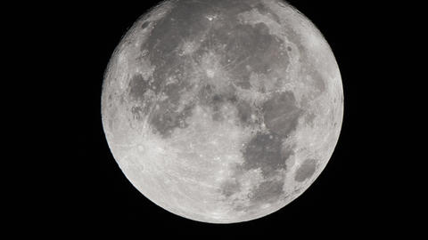 Real-time very detailed UHD extreme closeup shot of the moon Live Action