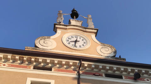 Historic building with clock in Bardolino in Italy Live Action