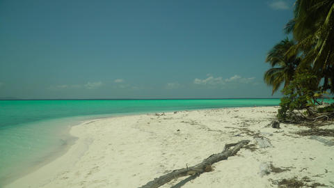 Tropical island with a beach on the atoll. Onok Island Balabac, Philippines Live Action