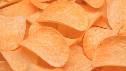 UHD closeup shot of the classic potatoe chips on a turntable Live Action