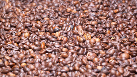 UHD closeup shot of the roasted coffee beans on a turntable Live Action